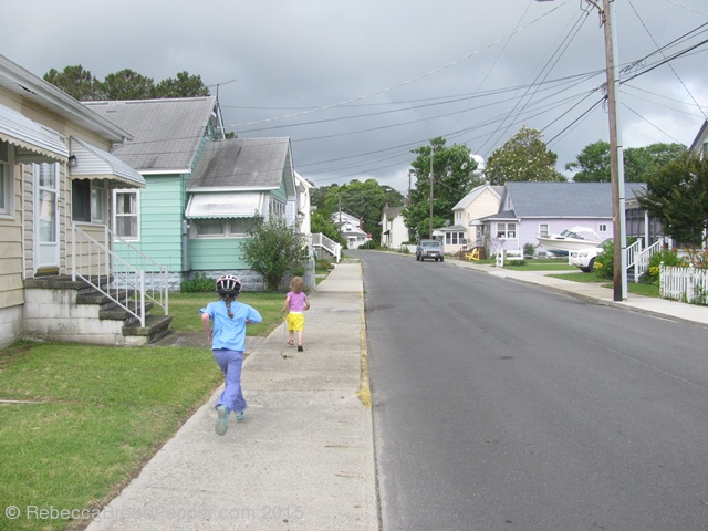 Girls running down a Chincoteague street.