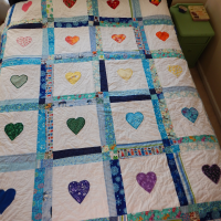 Rainbow Hearts and Unicorns Quilt