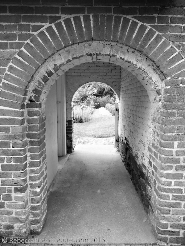 Garden through Brick Arches