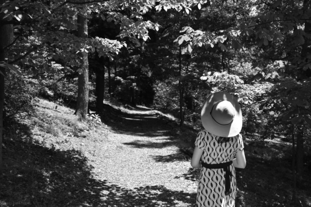 Girl in a Hat on a Woodland Path