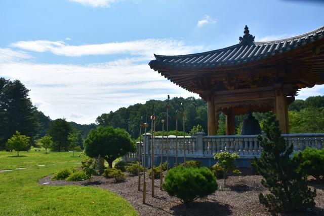 Bell, birds, and garden